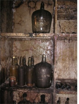 The scotch is sealed into glass containers (demijohns or giant bottles)